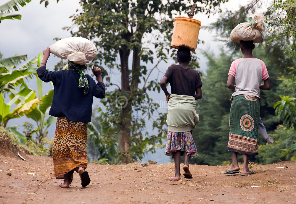 Women carry goods in Ngiresi Village, close to Arusha, Tanzania.