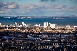 The coast of Fife and the a ship leaving the port of Leith, Edinburgh as seen from the Edinburgh Castle Esplanade.