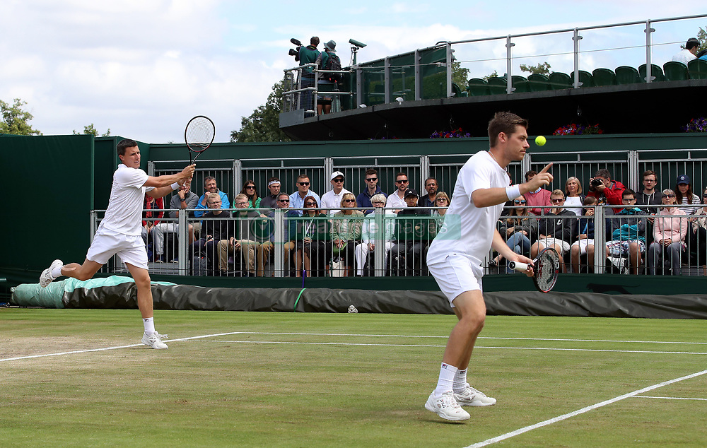 Ken and Neal Skupski (right) in action during their doubles match on day nine of the Wimbledon Championships at The All England Lawn Tennis and Croquet Club, Wimbledon.