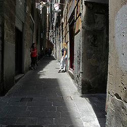 Prostitute in un carrugio nel centro storico di Genova. Prostitutes in an alley in the historical center of Genoa.