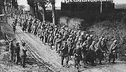 World War I 1914-1918: A column of French prisoners of war, escorted by German guards, marching to a prison camp behind the German lines, Somme, 1917. Military, Army, Soldier, Captivity, Defeat