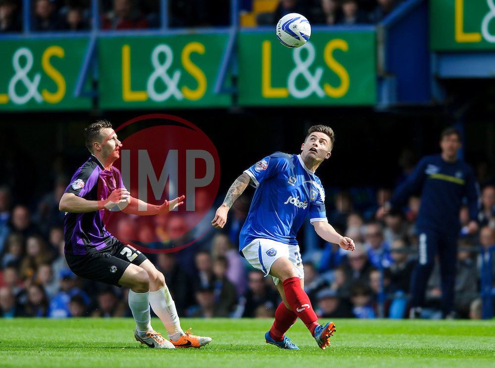 Seanan Clucas (NIR) of Bristol Rovers challenges Rhys McCabe (SCO) of Portsmouth - Photo mandatory by-line: Rogan Thomson/JMP - 07966 386802 - 19/04/2014 - SPORT - FOOTBALL - Fratton Park, Portsmouth - Portsmouth FC v Bristol Rovers - Sky Bet Football League 2.