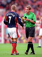 David Beckham (Manchester United) is booked by referee Graham Barber. Arsenal 1:0 Manchester United, F.A.Carling Premiership, 1/10/2000. Credit Colorsport / Stuart MacFarlane.