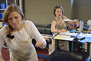 Lauren Laplante, right, helps Lindsay Whalen with her letterpress run during a workshop at the Windsor Printmakers Forum.