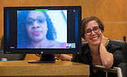 Trustee Anna Eastman poses for a photograph with Trustee Wanda Adams via Skype before a Houston ISD Board of Trustee meeting, October 13, 2016.