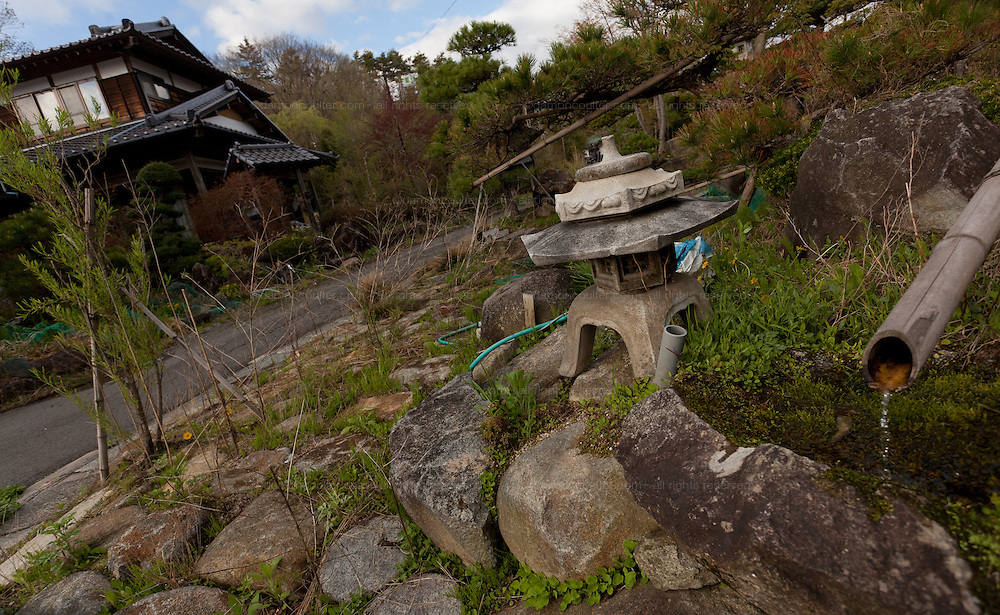 Lanterns, and empty houses in the abandoned village of Tsushima in Fukushima, Japan. Friday May 4th 2012. After the explosions at the Daichi nuclear plant caused by the March 11th 2011 earthquake and tsunami. High levels of radioactive contamination in this village have made it uninhabitable.