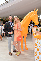 JODIE KIDD and DAVID BLAKELEY at the Veuve Clicquot Gold Cup Final at Cowdray Park Polo Club, Midhurst, West Sussex on 20th July 2014.