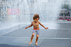 © Licensed to London News Pictures. 08/09/2016. London, UK. Four year-old Rose enjoys warm weather and sunshine at fountains of Royal Festival Hall in Southbank, London on Thursday, 8 September 2016.  Photo credit: Tolga Akmen/LNP
