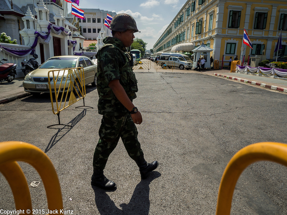 07 JULY 2015 - BANGKOK, THAILAND: A Thai soldier on duty at the Ministry of Defense. About 100 people gathered in front of the Ministry of Defense in Bangkok Tuesday to support 14 university students arrested two weeks ago for violating orders against political assembly. They're facing criminal trial in military courts. The courts ordered their release Tuesday because they can only be held for two weeks without trial, the two weeks expired Tuesday and the military court chose not to renew their pretrial detention. The court order was not an acquittal. They still face trial and possible prison sentences if convicted.        PHOTO BY JACK KURTZ