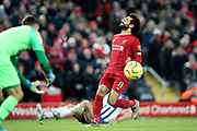 Liverpool forward Mohamed Salah (11) just can't connect with the cross ball during the Premier League match between Liverpool and Brighton and Hove Albion at Anfield, Liverpool, England on 30 November 2019.
