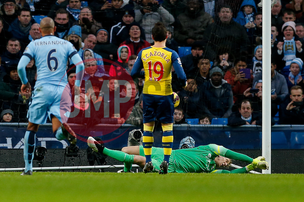 Santi Cazorla of Arsenal beats Joe Hart of Manchester City from the penalty spot to score a goal  and make it 0-1 - Photo mandatory by-line: Rogan Thomson/JMP - 07966 386802 - 18/01/2015 - SPORT - FOOTBALL - Manchester, England - Etihad Stadium - Manchester City v Arsenal - Barclays Premier League.