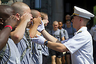 West Point, New York - A cadet corrects the salute of a new cadet during Reception Day at the United States Military Academy at West Point, New York. About 1,200 cadet candidates, the West Point Class of 2018, reported to the academy to begin their military careers by getting lessons in marching, military courtesy and discipline.