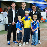 St Johnstone v Bristol City....28.07.12  Pre-Season Friendly<br /> Frazer Wright and Callum Davidson with a family<br /> Picture by Graeme Hart.<br /> Copyright Perthshire Picture Agency<br /> Tel: 01738 623350  Mobile: 07990 594431