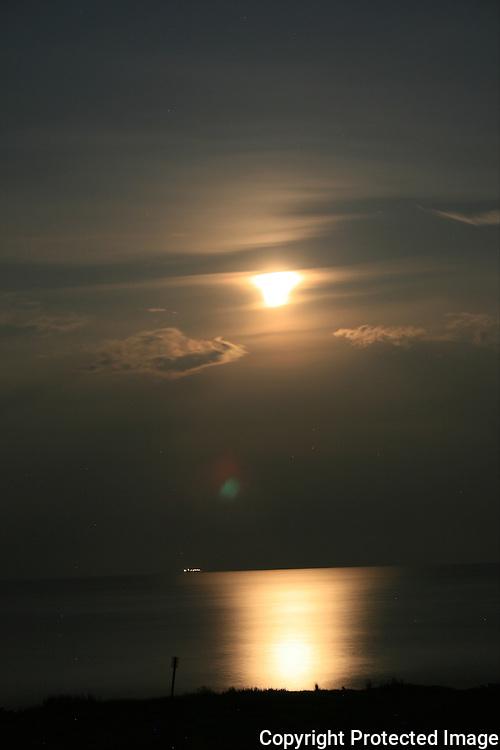 Jekyll Island moonrise with ship on horizon