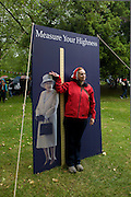 A royal parody stall invites Londoners to measure their own against the Queen's as the great British public brave bad weather to celebrate the Queen's Diamond Jubilee flotilla on the river Thames. 1,000 boats made their way past Battersea Park, London including their reigning monarch of 60 years and other members of the royal family during a weekend of official festivities and street parties.