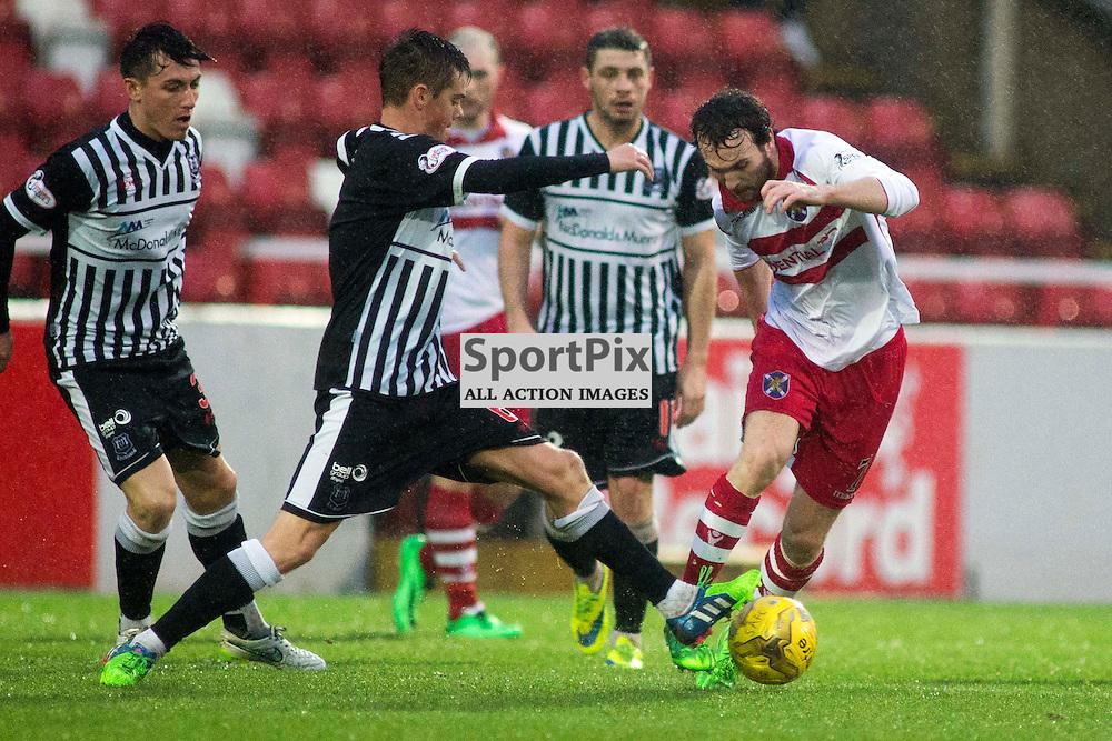Thomas Riley (Elgin 6) and Mark Lamont (Stirling 7) in the Stirling Albion v Elgin City Forthbank 05 December 2015<br /><br />(c) Russell G Sneddon / SportPix.org.uk