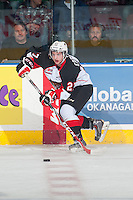 KELOWNA, CANADA - DECEMBER 5: Joseph Carvalho #27 of Prince George Cougars passes the puck against the Kelowna Rockets on December 5, 2014 at Prospera Place in Kelowna, British Columbia, Canada.  (Photo by Marissa Baecker/Shoot the Breeze)  *** Local Caption *** Joseph Carvalho;
