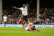 Fulham forward Aboubakar Kamara (47) fouls Barnsley midfielder Andy Yiadom (17) during the EFL Sky Bet Championship match between Fulham and Barnsley at Craven Cottage, London, England on 23 December 2017. Photo by Andy Walter.