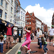 A street scene in Dublin City Centre as youngsters interact with a street performer making giant bubbles. Dublin, Ireland. Photo Tim Clayton