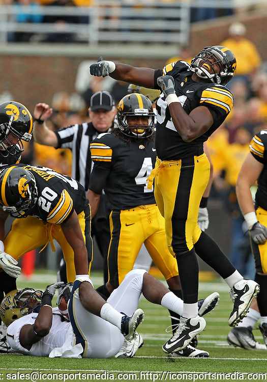 September 17, 2011: Iowa Hawkeyes defensive lineman Broderick Binns (91) is pumped up after a play during the first half of the game between the Iowa Hawkeyes and the Pittsburgh Panthers at Kinnick Stadium in Iowa City, Iowa on Saturday, September 17, 2011. Iowa defeated Pittsburgh 31-27.