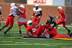 18 AUG 2007:  Keenan Wimbley takes down Cortes Rice.The Illinois State Redbirds, ranked in the top 10 in pre-season polls, prepare for the beginning of the season during the annual Red/White inter-squad scrimmage on the newly installed turf at Hancock stadium in Normal Illinois.