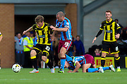 Burton Albion's Matt Palmer challenges for the ball with Stephen Dawson (C) during the Sky Bet League 1 match between Burton Albion and Scunthorpe United at the Pirelli Stadium, Burton upon Trent, England on 8 August 2015. Photo by Aaron Lupton.