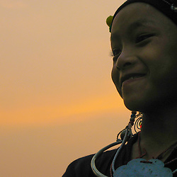 A young H'mong girl in Northern Laos at sunset, Northern Laos.