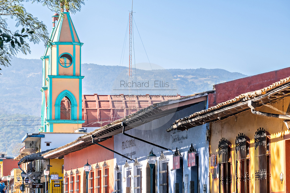 Colorful Spanish colonial style buildings on Luis de San Jose street in the central historic district of Coatepec, Veracruz State, Mexico.