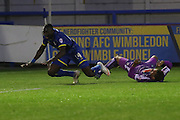Adebayo Azeez AFC Wimbledon is fouled by Gary Sawyer during the Johnstone's Paint Trophy match between AFC Wimbledon and Plymouth Argyle at the Cherry Red Records Stadium, Kingston, England on 1 September 2015. Photo by Stuart Butcher.
