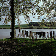 'Salmon Nets, Paxton House, 2013'  from 'A Fine Line - Exploring Scotland's Border with England' by Colin McPherson.<br /> <br /> Nets drying at Paxton House at the site of the last salmon netting station on the Scottish side of the river Tweed. Laws governing salmon fishing using a net and boat are different on each side of the border.<br /> <br /> The project was a one-year exploration of the border between the two historic nations, as seen from the Scottish side of the frontier.<br /> <br /> Colin McPherson is a photographer and visual artist based in north west England. In 2012 he was one of the founding members of Document Scotland, a collective of four Scottish documentary photographers brought together by a common vision to witness and photograph the important and diverse stories within Scotland at one of the most important times in our nation's history.<br /> <br /> 'A Fine Line' will be shown for the first time in public at Impressions Gallery, Bradford, from July 1 until September 27, 2014 to coincide with the Scottish Independence referendum.