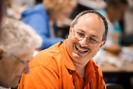 The Rev. Michael Belinsky, pastor of Our Savior Lutheran Church in Benzonia, Mich., talks with a fellow delegate at the 66th Regular Convention of The Lutheran Church–Missouri Synod on Sunday, July 10, 2016, at the Wisconsin Center in Milwaukee. LCMS/Michael Schuermann
