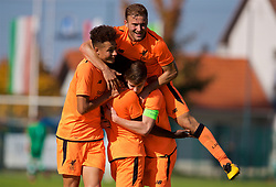 LENDAVA, SLOVENIA - Tuesday, October 17, 2017: Liverpool's Bobby Adekanye [centre] celebrates scoring the fourth goal with team-mates Curtis Jones, Herbie Kane and captain Ben Woodburn during the UEFA Youth League Group E match between NK Maribor and Liverpool at Športni Park. (Pic by David Rawcliffe/Propaganda)