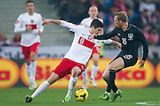 Poland's Robert Lewandowski (L) fights for the ball with Paul Green of Ireland (R) during international friendly soccer match between Poland and Ireland at Inea Stadium in Poznan on November 19, 2013.<br /> <br /> Poland, Poznan, November 19, 2013<br /> <br /> Picture also available in RAW (NEF) or TIFF format on special request.<br /> <br /> For editorial use only. Any commercial or promotional use requires permission.<br /> <br /> Mandatory credit:<br /> Photo by &copy; Adam Nurkiewicz / Mediasport