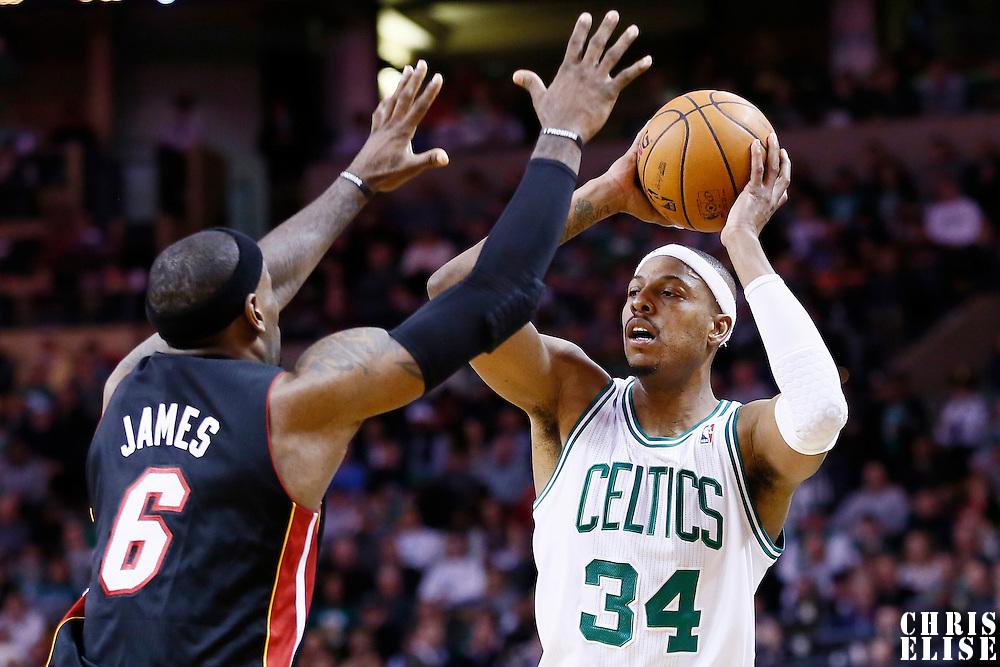 27 January 2013: Boston Celtics small forward Paul Pierce (34) looks to pass the ball over Miami Heat small forward LeBron James (6) during the Boston Celtics 100-98  2OT victory over the Miami Heat at the TD Garden, Boston, Massachusetts, USA.
