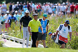 September 2, 2018 - Norton, Massachusetts, United States - Bryson DeChambeau and Tiger Woods walk across a bridge on the 8th hole during the third round of the Dell Technologies Championship. (Credit Image: © Debby Wong/ZUMA Wire)