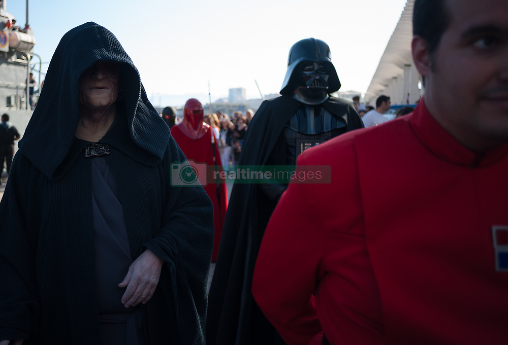 May 5, 2018 - Malaga, Spain - A member of the 501st Legion Spanish Garrison dressed as ''Darth Vader'' and ''Darth Sidipus'' from the movie saga Star Wars, perform as they walk during a charity parade in favour of bone marrow donation, organized by the Luis Olivares foundation. Hundreds of volunteers from the 501st Legion Spanish Garrison, an association that promote the hobby for the movie Star Wars and contribute in solidarity causes, took the main streets in downtown Málaga with the objective of encourage the bone marrow donation and the fight against cancer. (Credit Image: © Jesus Merida/SOPA Images via ZUMA Wire)