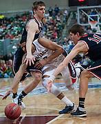 Angel Nunez powers through defenders en route to a dunk. (Austin Ilg photo, Gonzaga Bulletin)