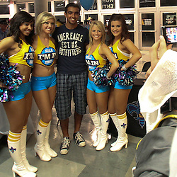 April 24, 2011; New Orleans, LA, USA; A New Orleans Hornets fan poses for a picture with members of the Honeybees dance team before tip off of game four of the first round of the 2011 NBA playoffs at the New Orleans Arena.    Mandatory Credit: Derick E. Hingle