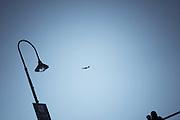 Jet passing streetlamp, Glenelg (Adelaide), South Australia, Australia