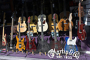 Electric and acoustic guitars on display in Martin & Co, one of the last music shops to stay in Denmark Street in London's famous Tin Pan Alley, a result of lease issues and rent hikes.