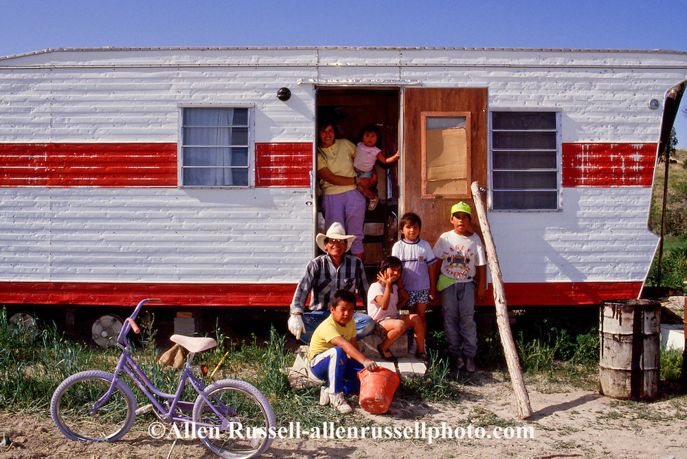 Pine Ridge Sioux Indian Reservation, South Dakota, Sioux (Lakota) Indian family at home in travel trailer