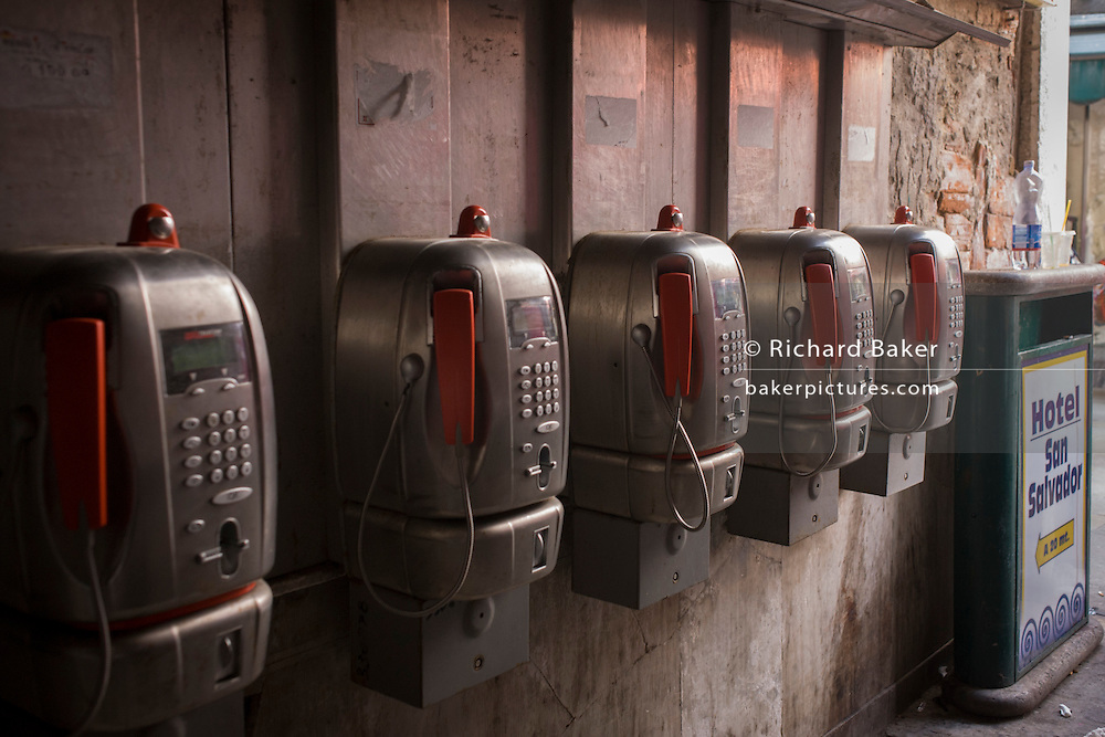 Old and unused public telephones in a narrow street in the San Marco district of Venice, Italy.