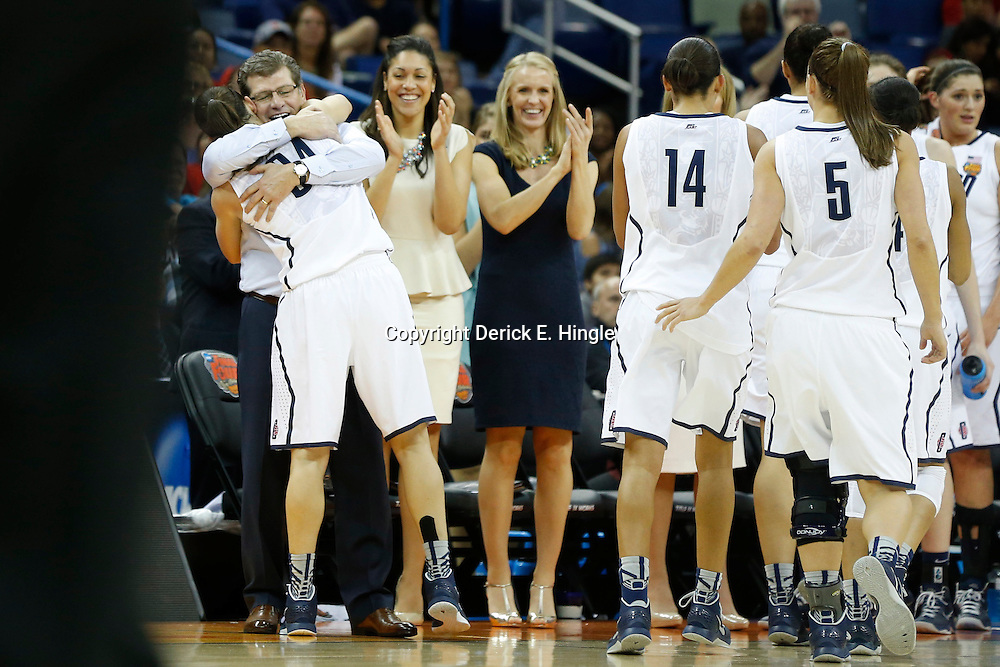 Apr 9, 2013; New Orleans, LA, USA; Connecticut Huskies head coach Geno Auriemma hugs guard Kelly Faris (34) against the Louisville Cardinals during the second half of the championship game in the 2013 NCAA womens Final Four at the New Orleans Arena. Mandatory Credit: Derick E. Hingle-USA TODAY Sports
