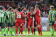 Tempers being to flair during the Sky Bet League 2 match between Crawley Town and AFC Wimbledon at the Checkatrade.com Stadium, Crawley, England on 15 August 2015. Photo by Michael Hulf.