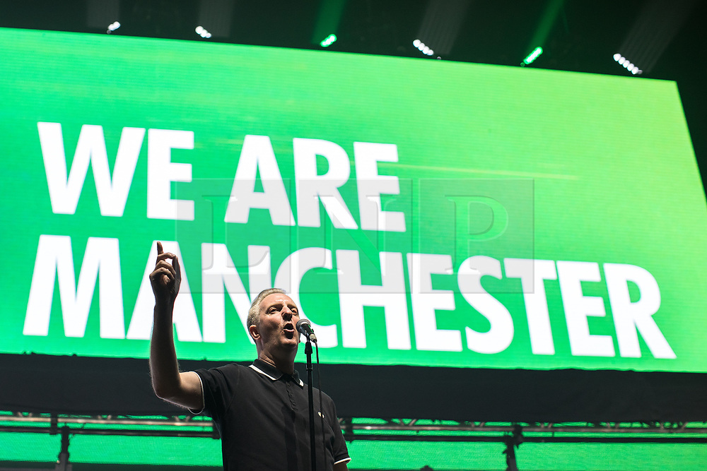 © Licensed to London News Pictures . 09/09/2017. Manchester , UK . Tony Walsh (aka Longfella) reads his poem , This is the Place . We Are Manchester reopening charity concert at the Manchester Arena with performances by Manchester artists including  Noel Gallagher , Courteeners , Blossoms and the poet Tony Walsh . The Arena has been closed since 22nd May 2017 , after Salman Abedi's terrorist attack at an Ariana Grande concert killed 22 and injured 250 . Money raised will go towards the victims of the bombing . Photo credit: Joel Goodman/LNP