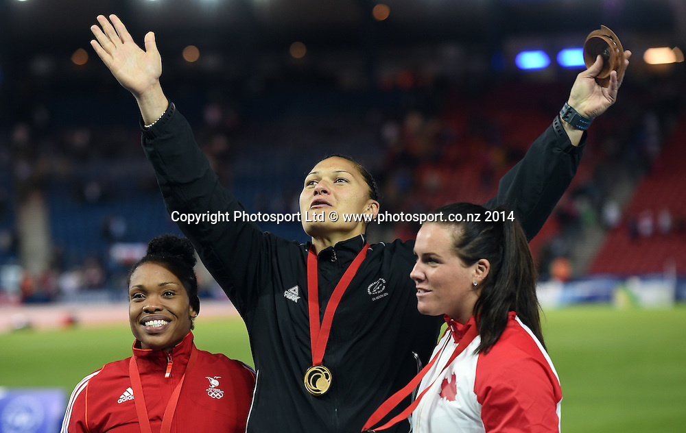 Gold Medalist New Zealand's Valerie Adams with Trinidad and Tobago Silver Medalist Cleopatra Borel and Canadian bronze medalist Julie Labonte. Women's Shot Put Final. Track and Field at Hampden Park. Glasgow Commonwealth Games 2014. Wednesday 30 July 2014. Scotland. Photo: Andrew Cornaga/www.Photosport.co.nz