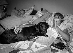 Ellen in Bed. Ellen Smith, a wife, mother and former teacher who lives with a rare genetic disorder called Ehlers Danlos Syndrome. RI, 2010.