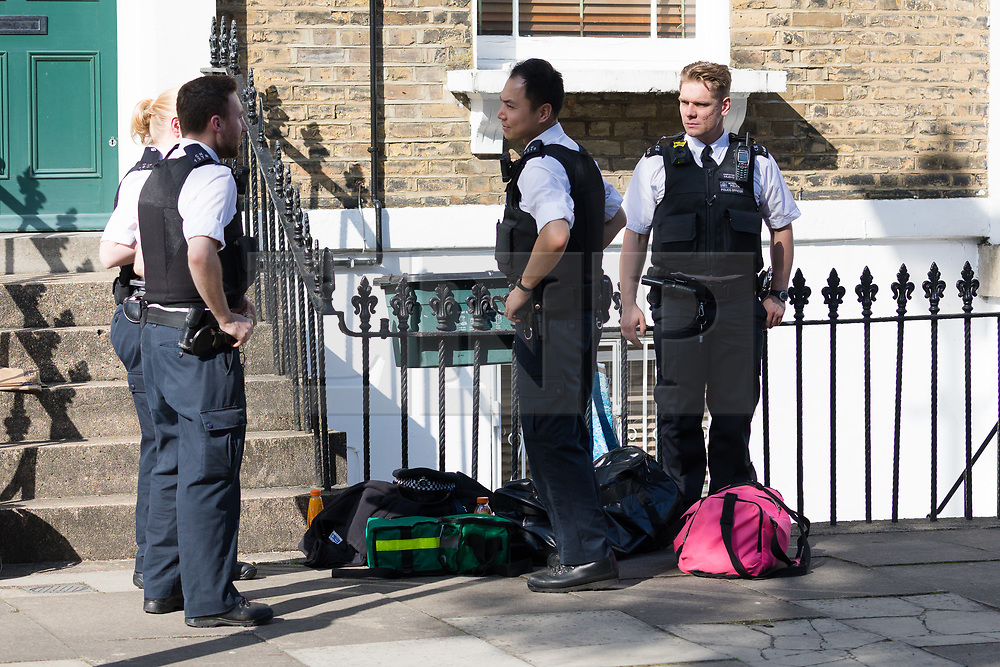 © Licensed to London News Pictures. 25/08/2017. LONDON, UK.  Police officers leaving the scene in Mitchison Road, off Essex Road in Islington. A 27 year old man was stabbed on Thursday evening and later died in hospital. Photo credit: Vickie Flores/LNP