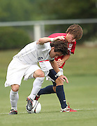May 12, 2012; Huntsville, AL, USA; Oak Mountain's Wes Sandlin (3) struggles for the ball with Auburn's Jack Goldberg (6). Mandatory Credit: Marvin Gentry