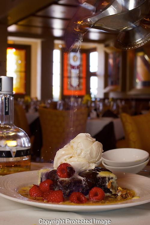 Eddie Merlot's Vanilla Cognac Brownie layered in hot fudge, pecans, vanilla bean ice cream flamed with Navan vanilla liqueur. (Jodi Miller/Alive).
